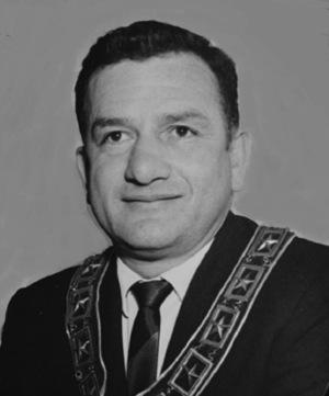 John G. Yogi Markos